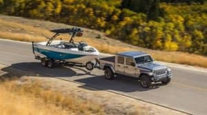 gladiator-hauling-a-boat-on-road