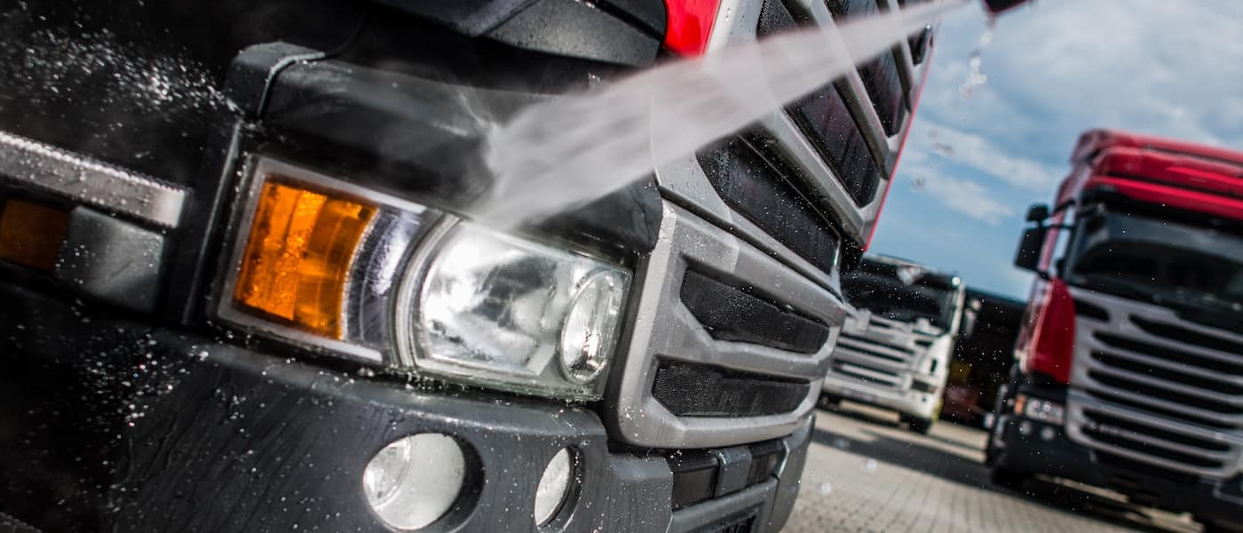 semi truck headlights being washed