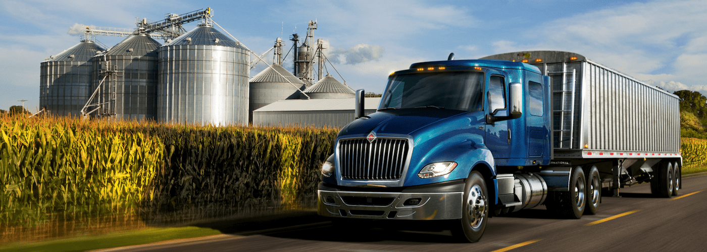 2020 international lt series blue exterior driving done road with corn in background