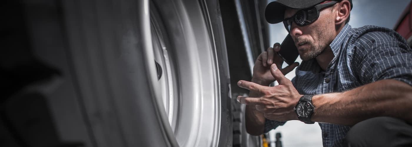 truck mechanic checking tires