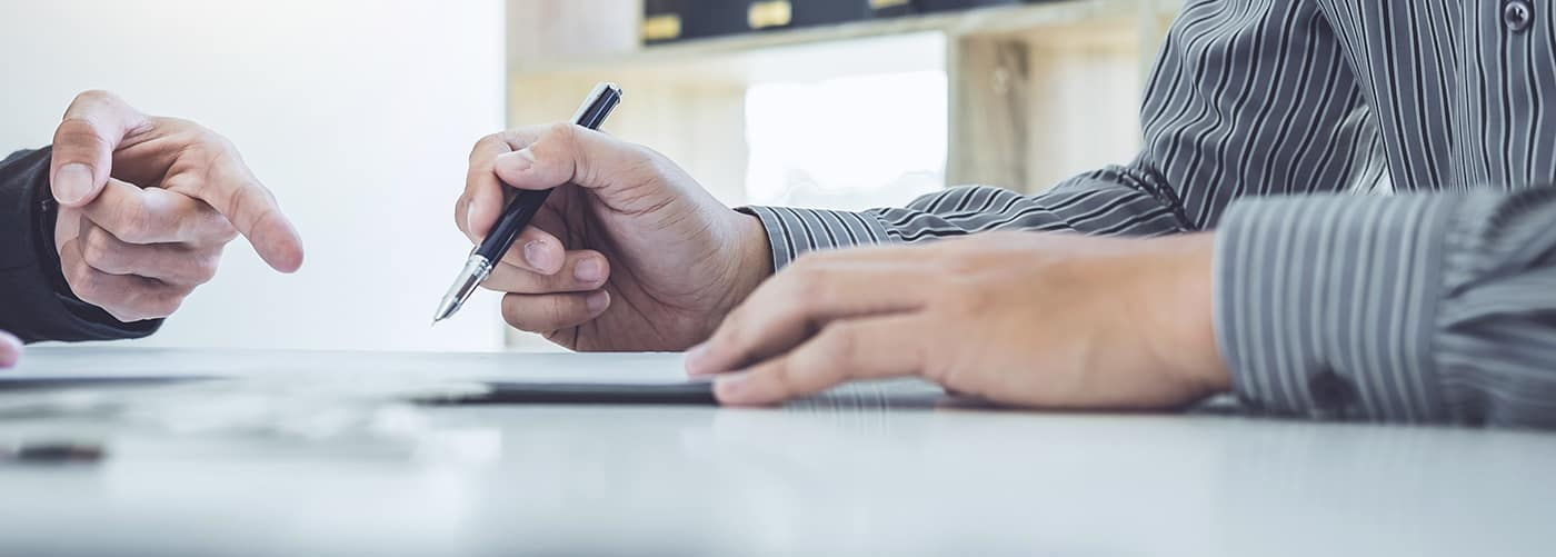 Man signing contract paperwork