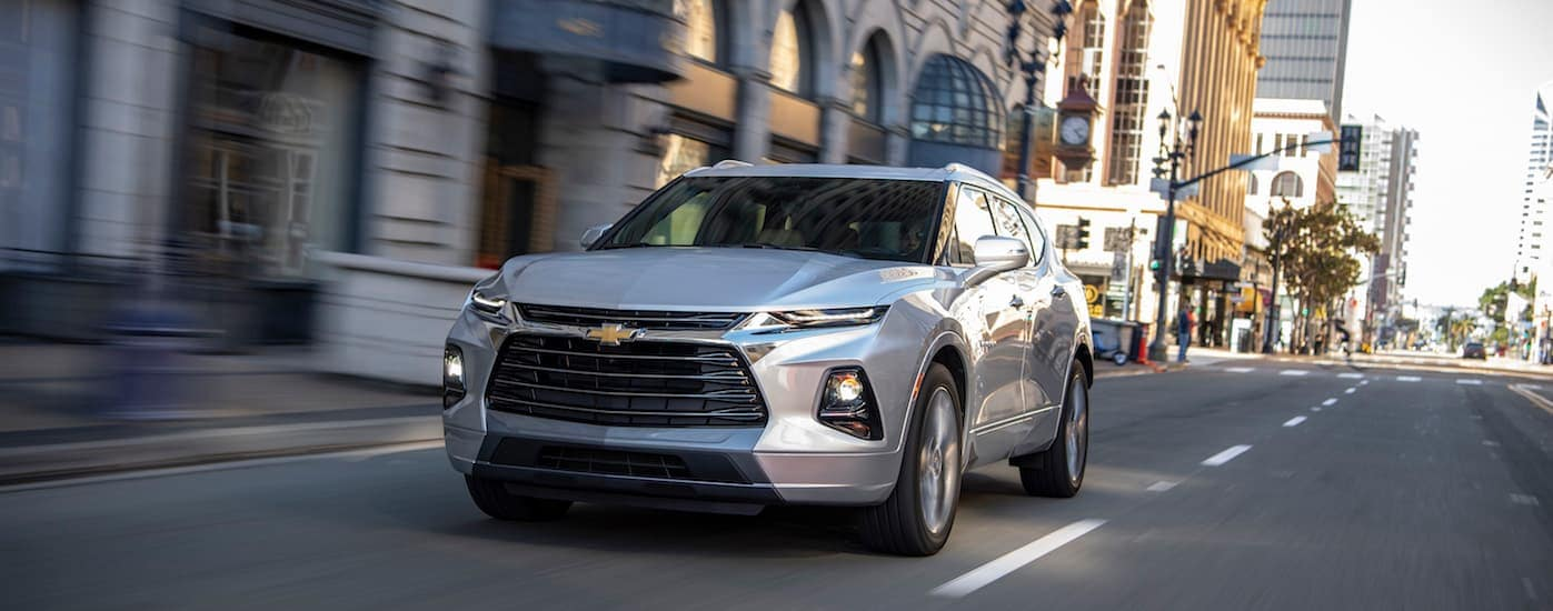 A gray 2019 Chevy Blazer driving near Buford, GA after leaving a local Chevrolet dealer.