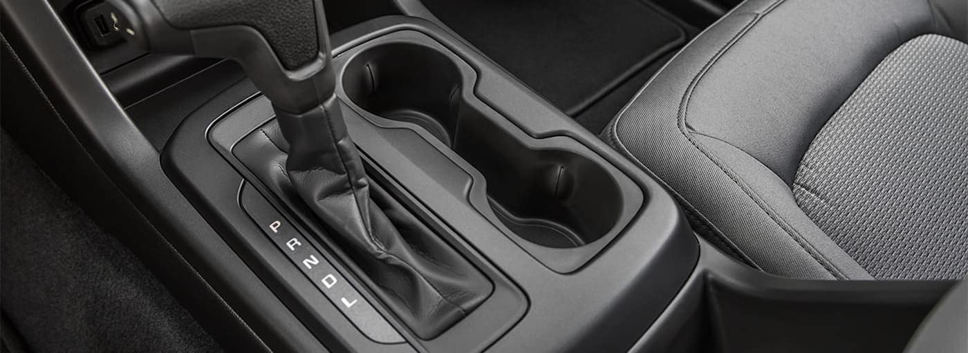 A closeup of the shifting lever in the 2019 Chevy Colorado is shown.