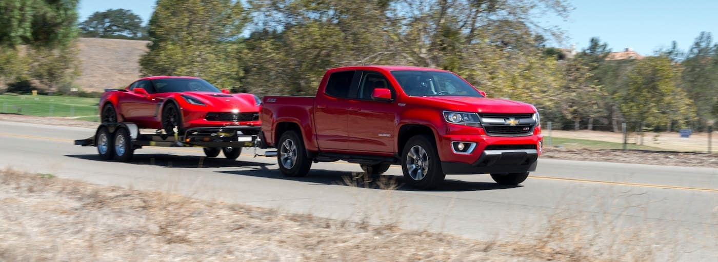 A red 2019 Chevrolet Colorado is towing a Corvette near Buford, GA.