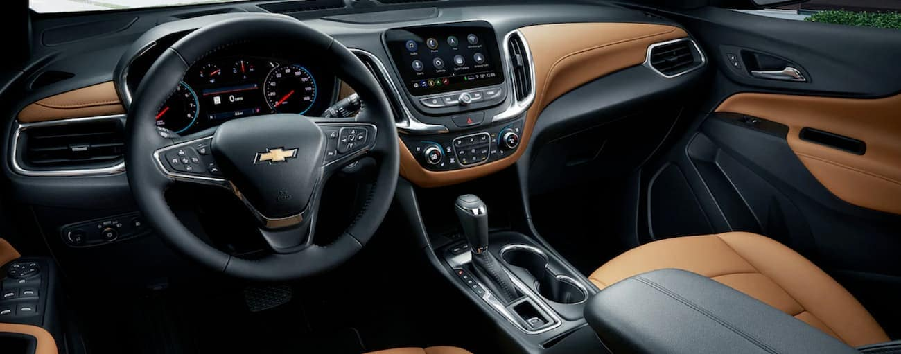 The black and tan interior of the 2019 Chevy Equinox is shown.