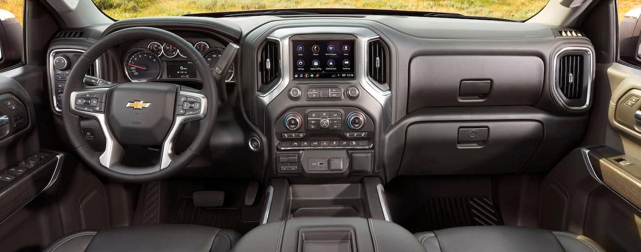 The black interior of a 2019 Chevy Silverado 1500 is shown.