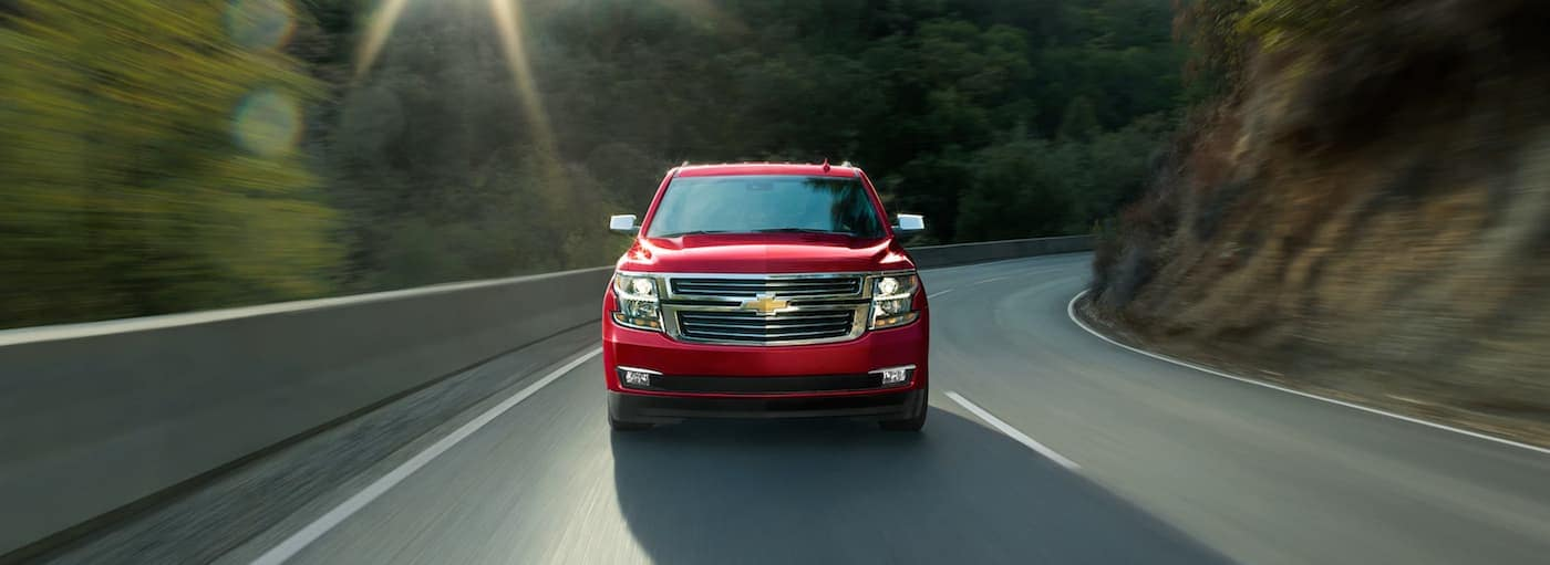A red 2019 Chevrolet Tahoe in Buford, GA is racing around a road
