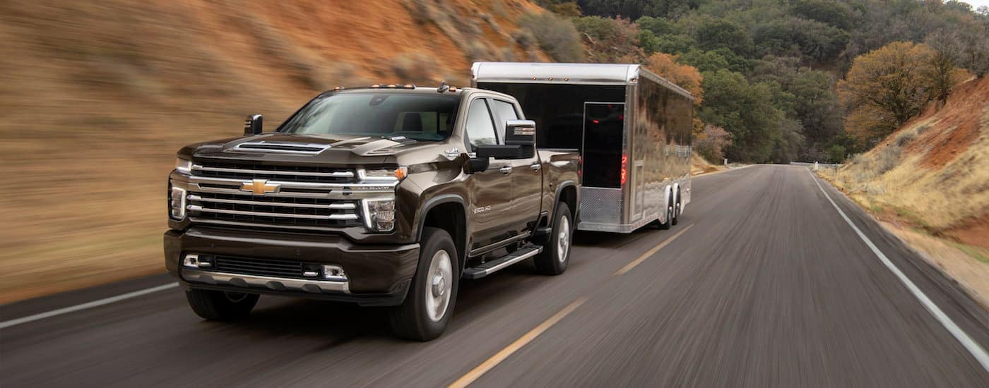 A 2020 Chevy Silverado 2500HD towing a large trailer near Buford, GA. You can find this truck at your local Chevrolet dealer.