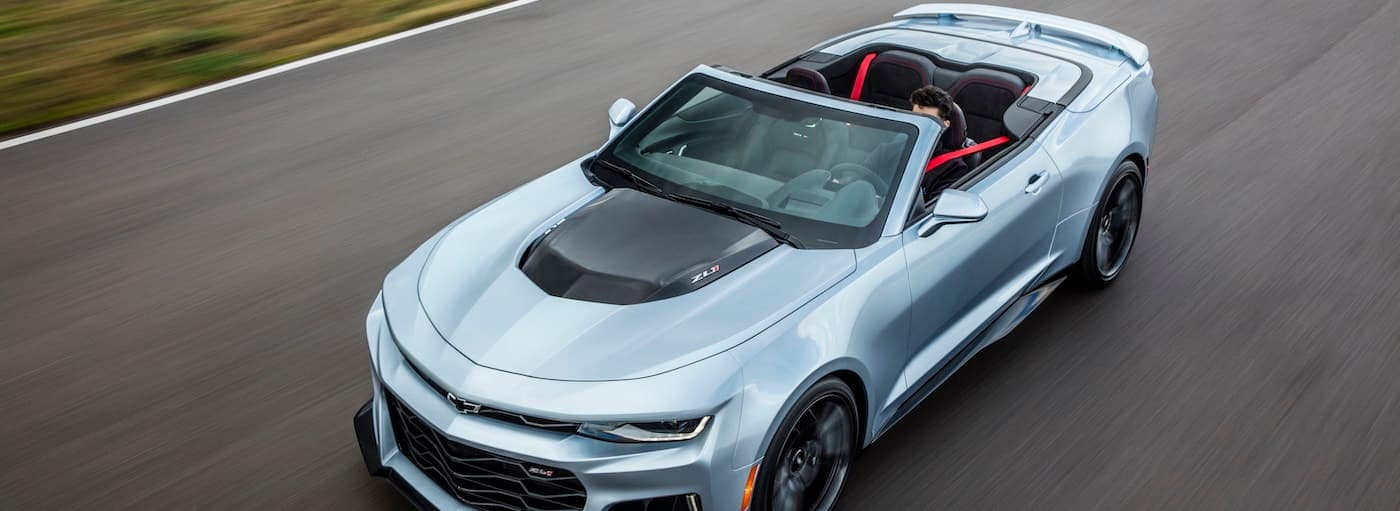 A silver convertible 2019 Chevrolet Camaro ZL1 is near Buford, GA on a track.