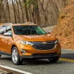 A 2019 Chevy Equinox driving on a paved backroad near Buford, GA.