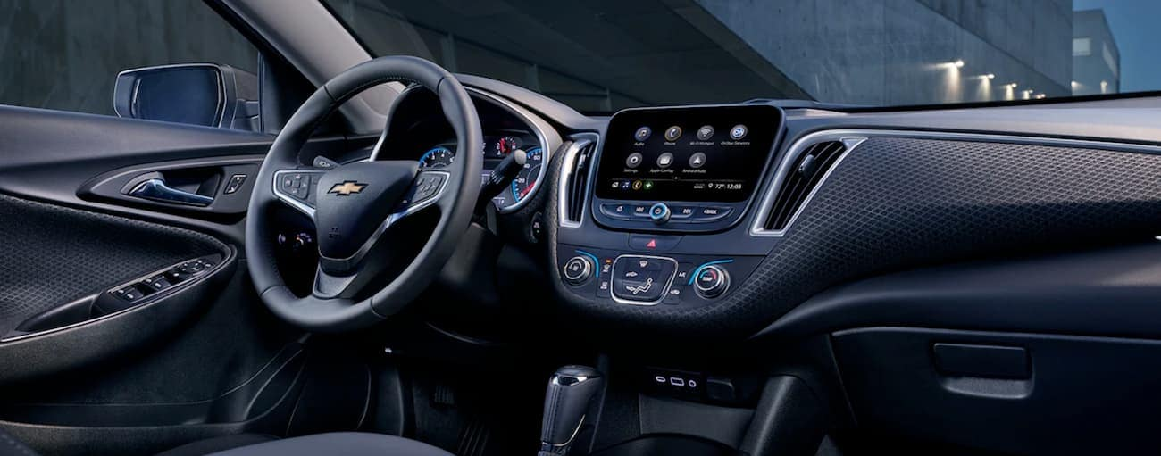 The black interior of a 2019 Chevy Malibu is shown.