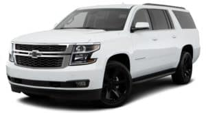 A white 2019 Chevy Suburban is facing left.