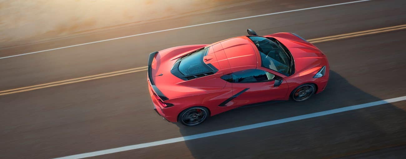 A red 2020 Chevy Corvette is shown driving from above in Buford, GA.