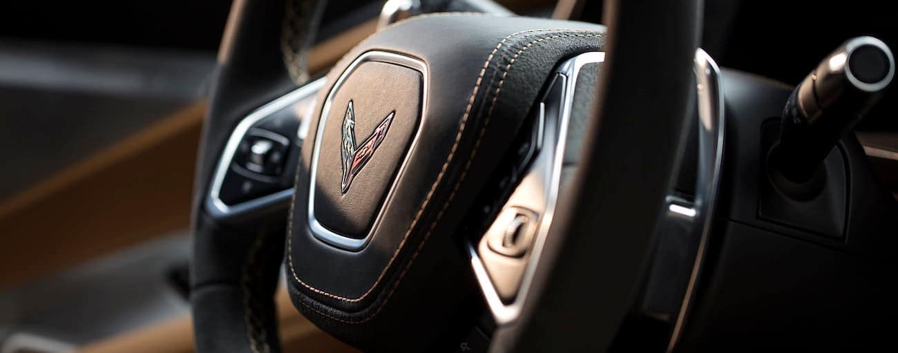 The black leather steering wheel of the 2020 Chevy Corvette is shown in a closeup.
