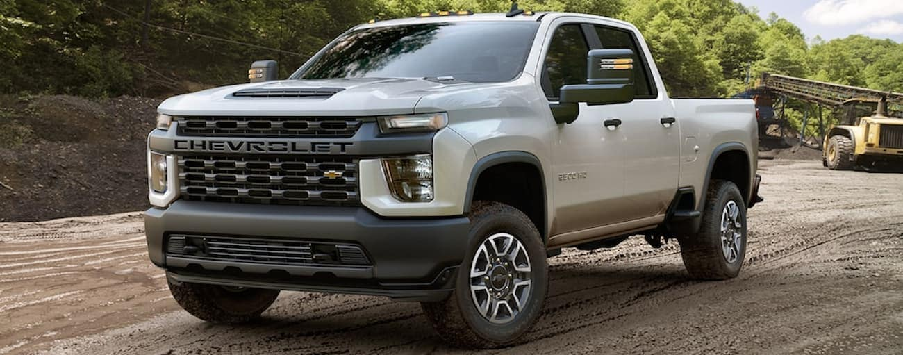 A white 2020 Chevy Silverado 2500HD Work Truck edition is parked on dirt near Buford, GA.