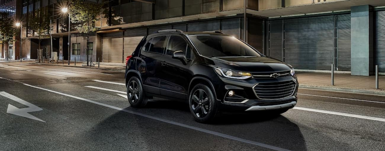 A black Midnight Edition 2019 Chevy Trax is driving at night near Buford, GA.
