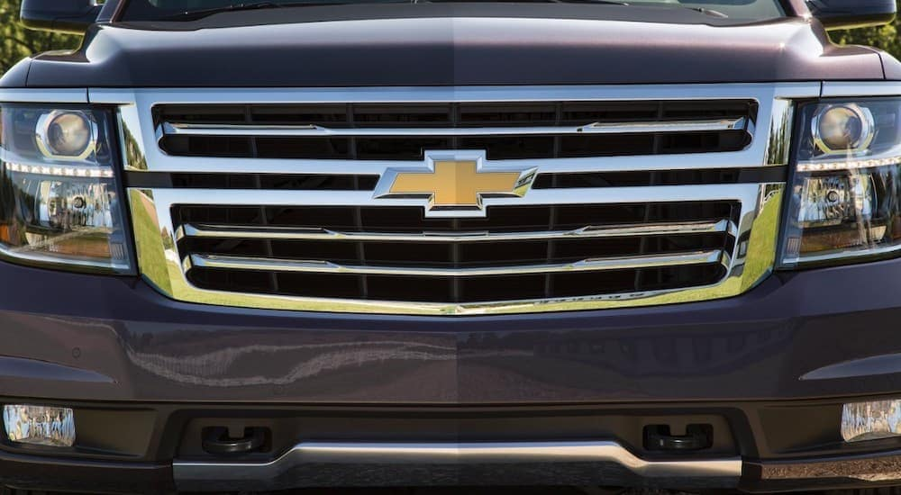 The front of a 2016 Chevy Tahoe is shown.