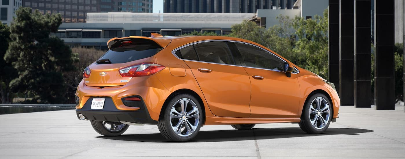 An orange 2017 Chevy Cruze hatch is parked at an Atlanta used car dealership.