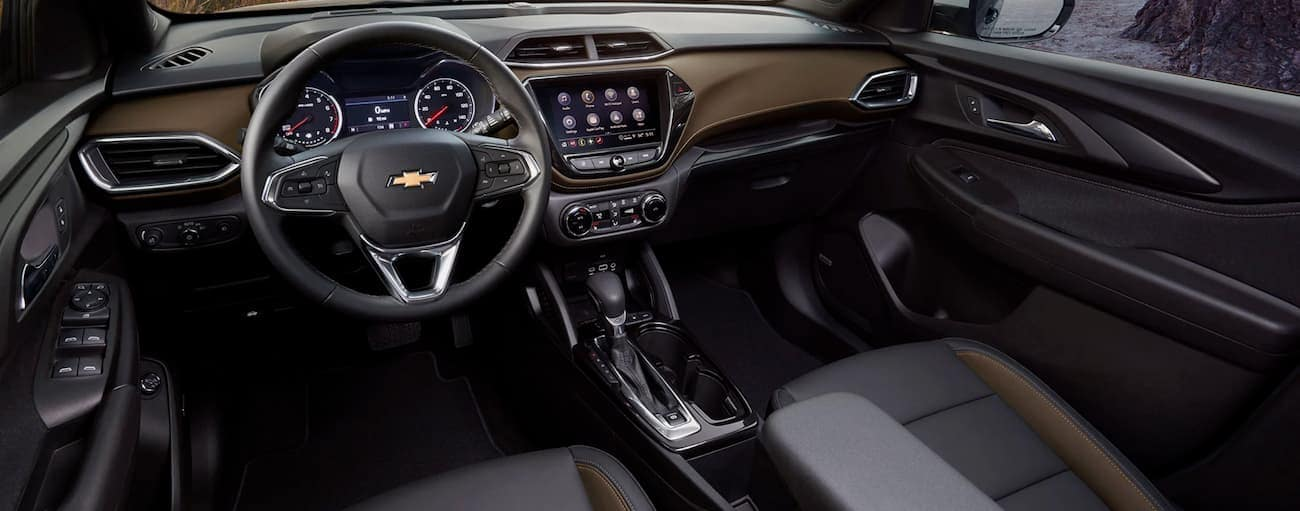 The black and wood grain interior in a 2021 Chevy Trailblazer is shown.
