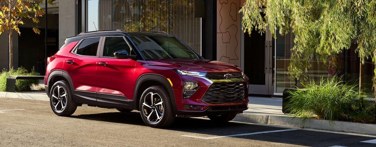 A red 2021 Chevy Trailblazer RS is parked on a downtown street.