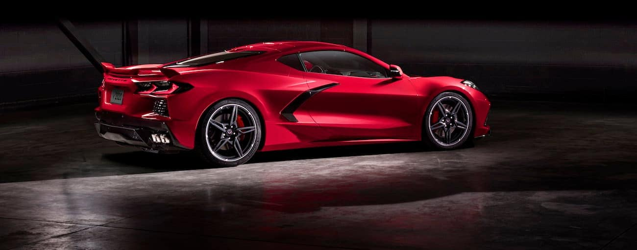 A red 2020 Chevy Corvette, which wins when comparing the 2020 Chevy Corvette vs 2019 Chevy Corvette, is parked in a dark parking garage.