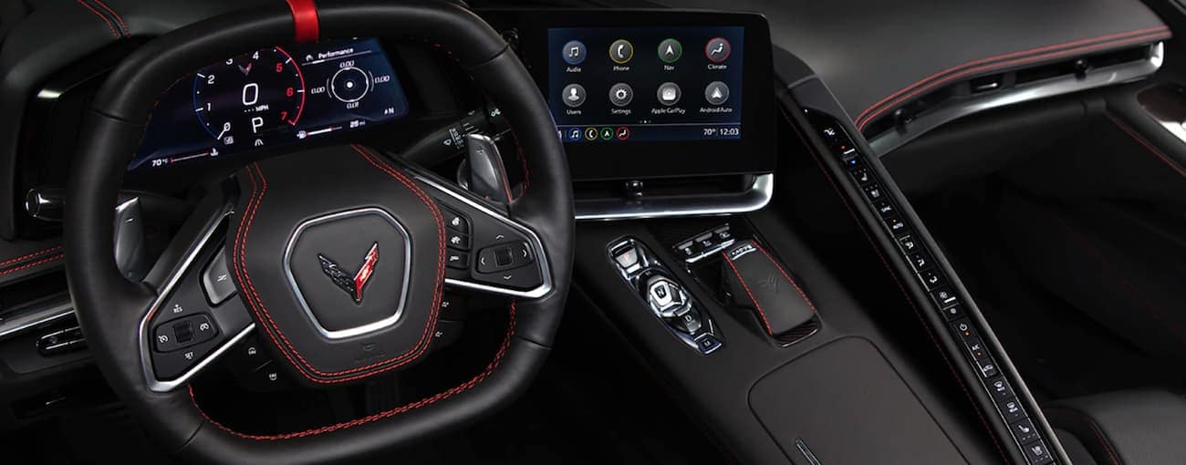 The red and black leather interior with new high tech features is shown in the 2020 Chevy Corvette.