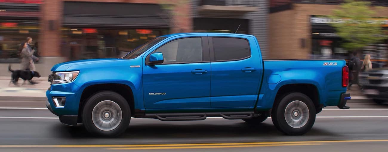 A blue 2020 Chevy Colorado is driving on a city street near Buford, GA.