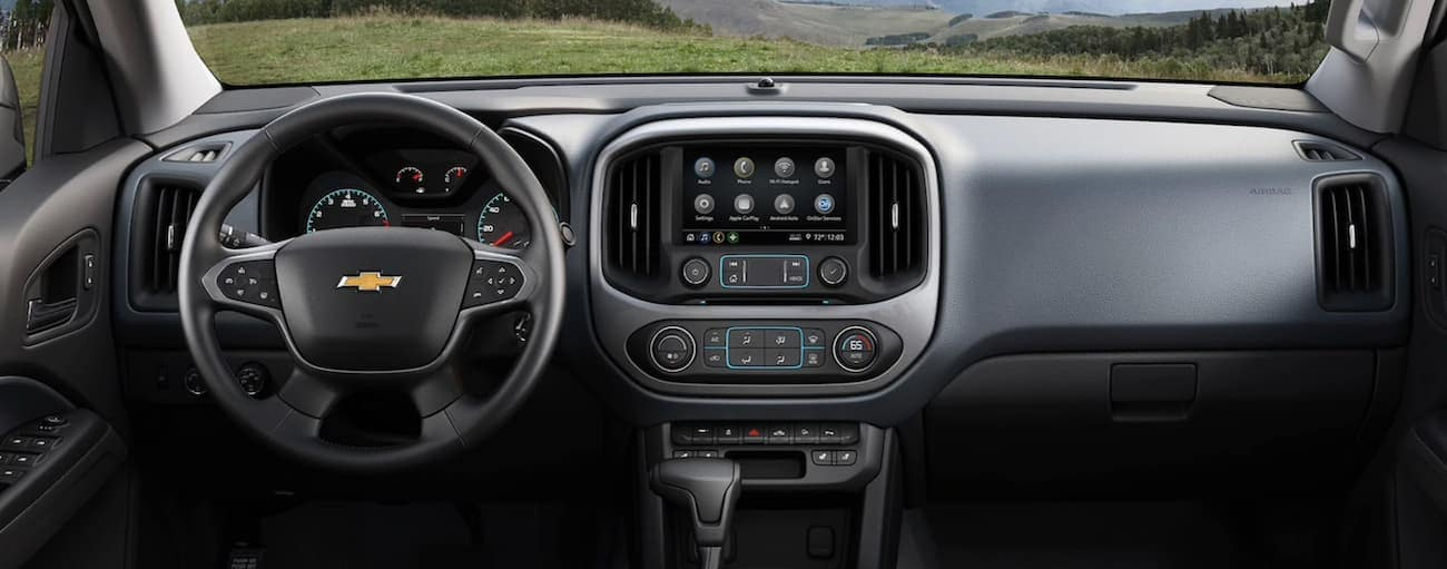 A look at the front interior of a 2020 Chevy Colorado with an infotainment system.
