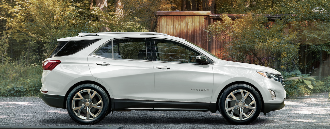 A white 2020 Chevy Equinox is parked on a gravel driveway in front of a small wooden building near Buford, GA.