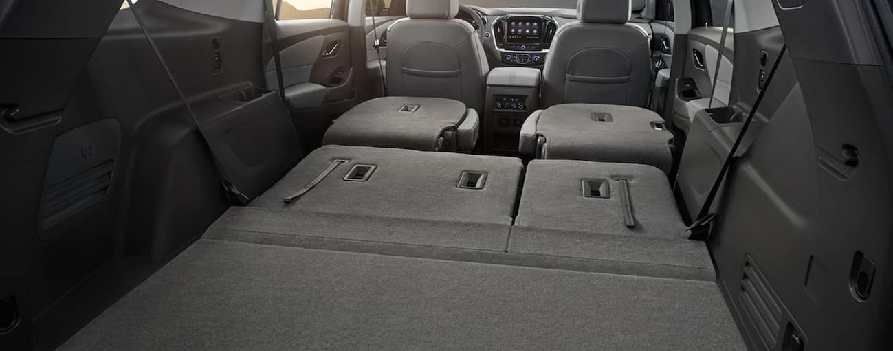 A view from the rear to the front of a 2020 Chevy Traverse with the backseats down is shown.
