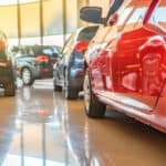 A close up of used cars parked in a showroom at a local used car dealership near Atlanta, GA.