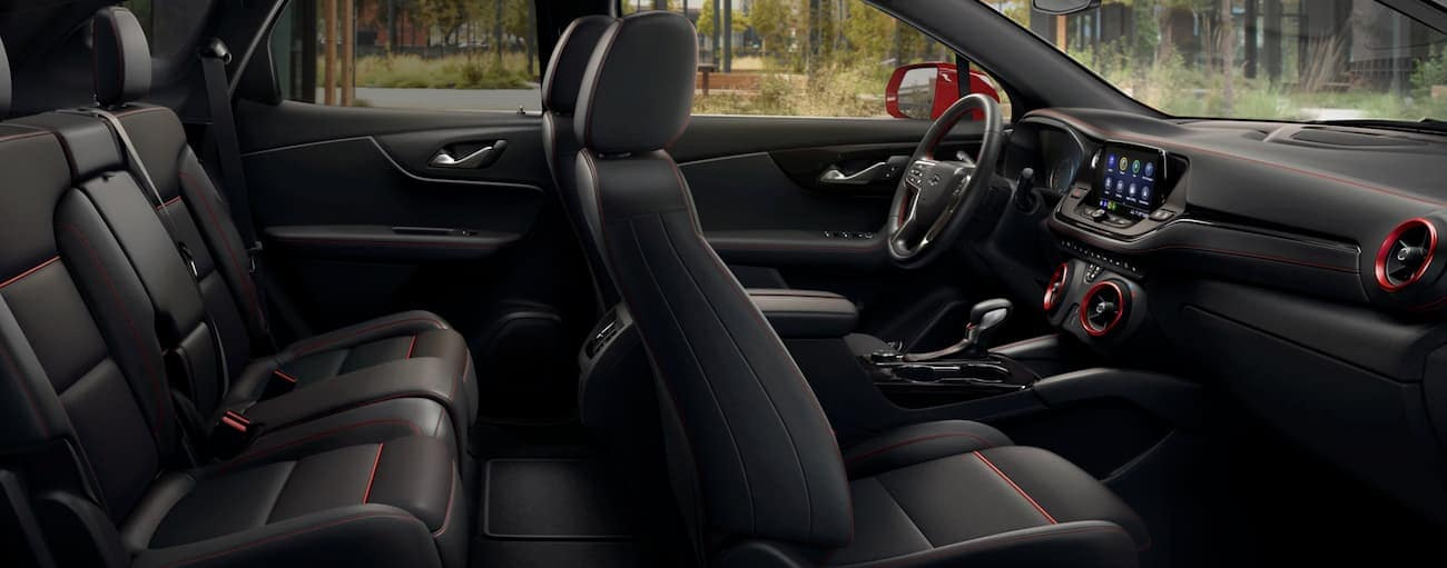 The black interior of a 2020 Chevy Blazer is shown from the side.