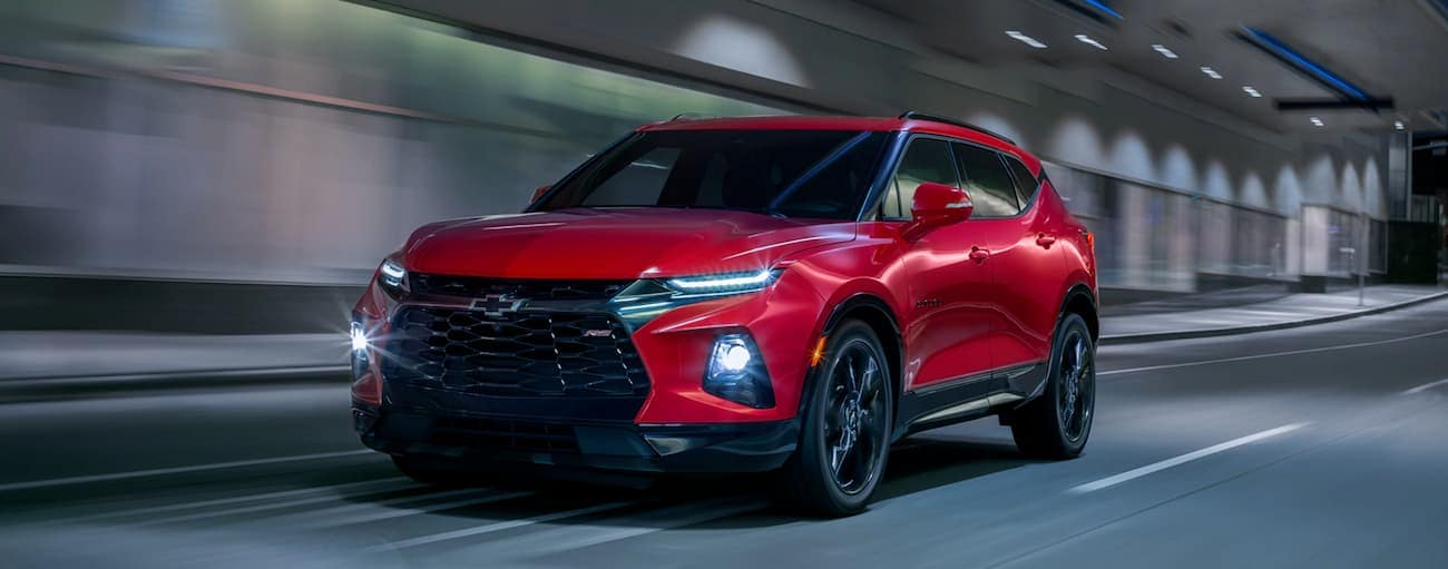 A red 2020 Chevy Blazer RS is driving through a tunnel.