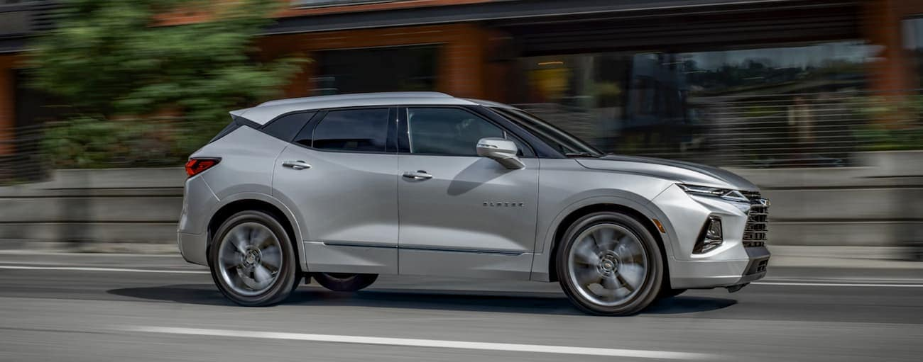 A silver 2020 Chevy Blazer is driving on a city street near Buford, GA.