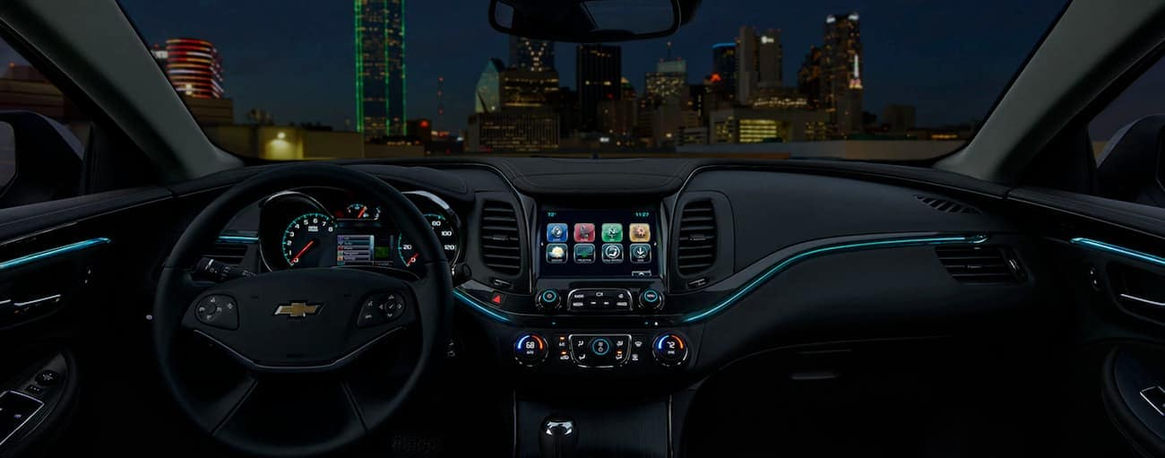 The interior of the 2020 Chevy Impala is shown at night.