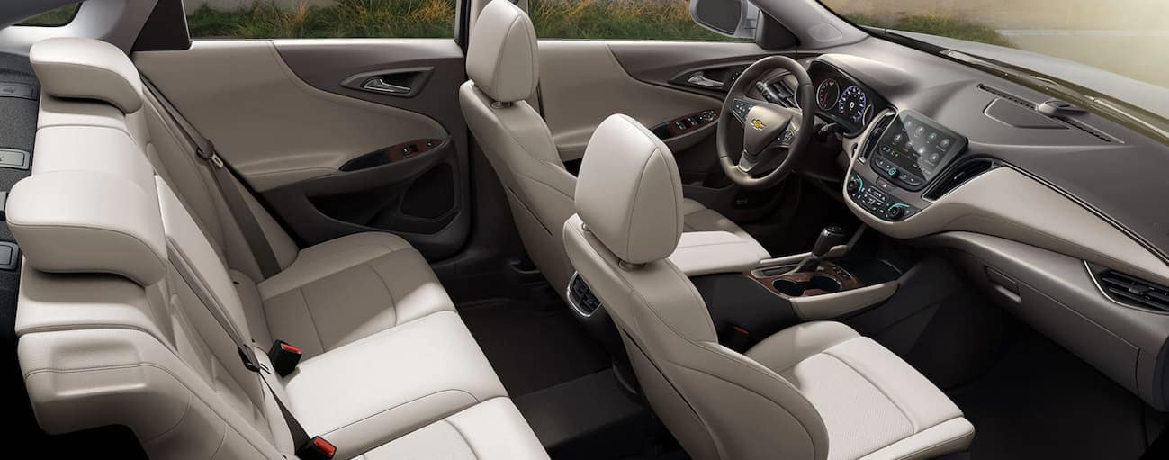 A birds eye view of the tan front and rear interior inside of a 2020 Chevy Malibu is shown.
