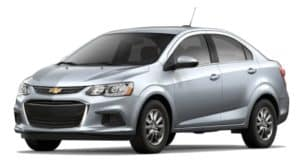 A silver 2020 Chevy Sonic sedan is facing left.