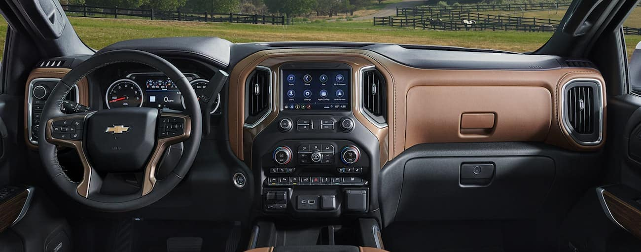 The front black and brown leather interior of a 2020 Chevy Silverado 1500 is shown.