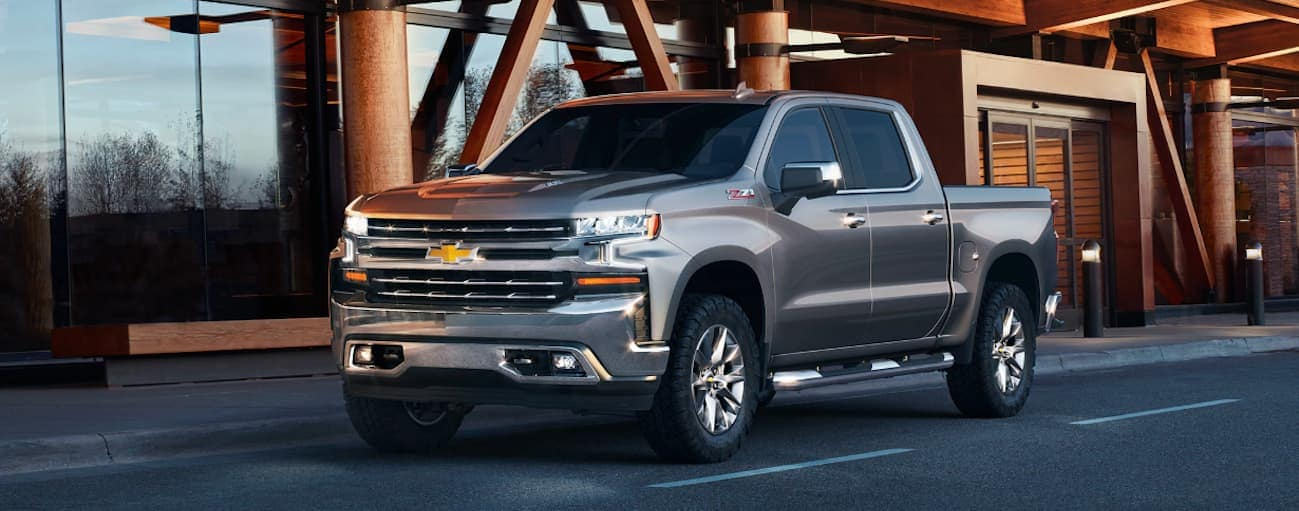 A silver 2020 Chevy Silverado 1500, which wins when comparing the 2020 Chevy Silverado 1500 vs 2020 Toyota Tundra, is parked at an airport near Buford, GA.