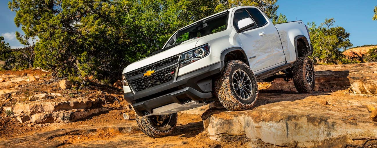 A white 2020 Chevy Colorado ZR2, which wins when comparing the 2020 Chevy Colorado vs 2020 Ford Ranger, is rock crawling near Buford, GA.