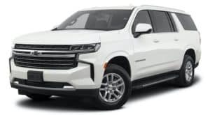 A 2021 Chevy Suburban is angled left.