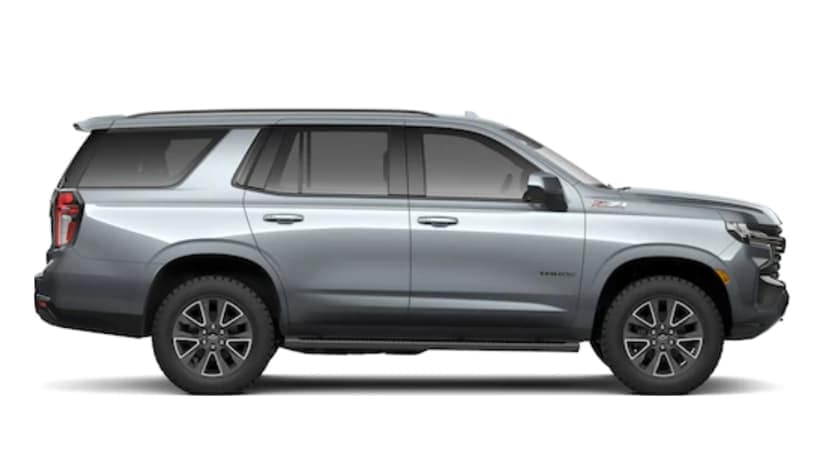 A silver 2021 Chevy Tahoe is facing right.