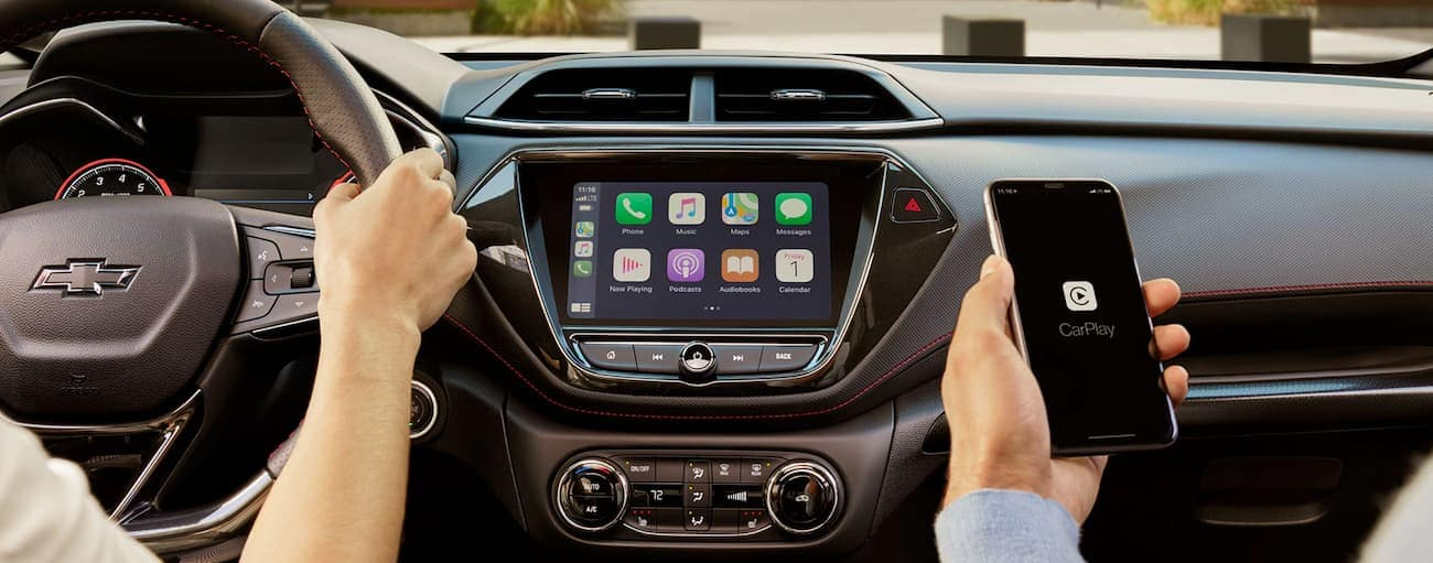 A phone is being used with the infotainment system in the 2021 Chevy Trailblazer.