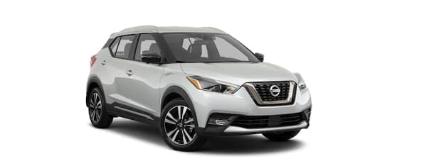 A white 2020 Nissan Kicks is facing right.