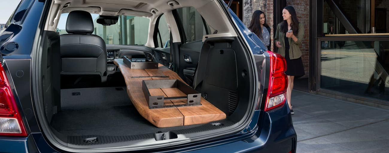 A table is shown in the cargo area of a 2020 Chevy Trax.
