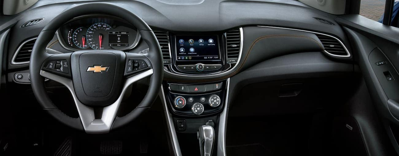The dashboard and infotainment features of a 2020 Chevy Trax are shown.