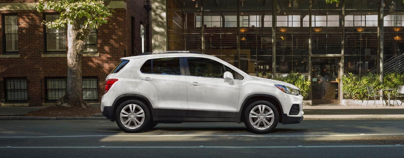 A white 2020 Chevy Trax, which wins when comparing the 2020 Chevy Trax vs 2020 Ford EcoSport, is parked on a city street.