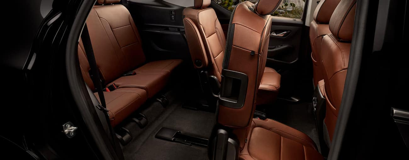 The rear seating in the brown interior of a 2020 Chevy Traverse is shown.