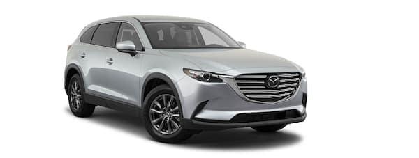 A silver 2020 Mazda CX-9 is facing right.