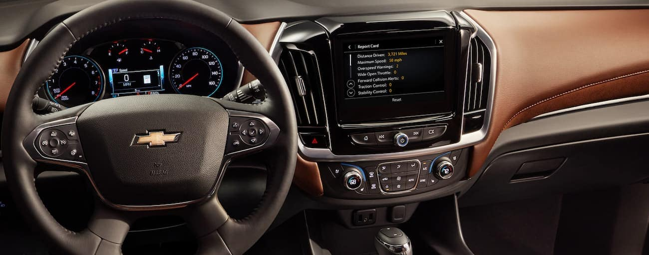 The brown dashboard on a 2020 Chevy Traverse is shown.